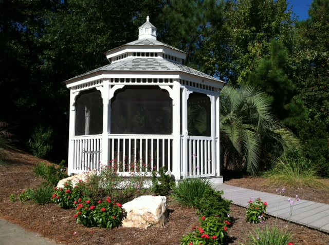 gazebo with two tiered roof and screens