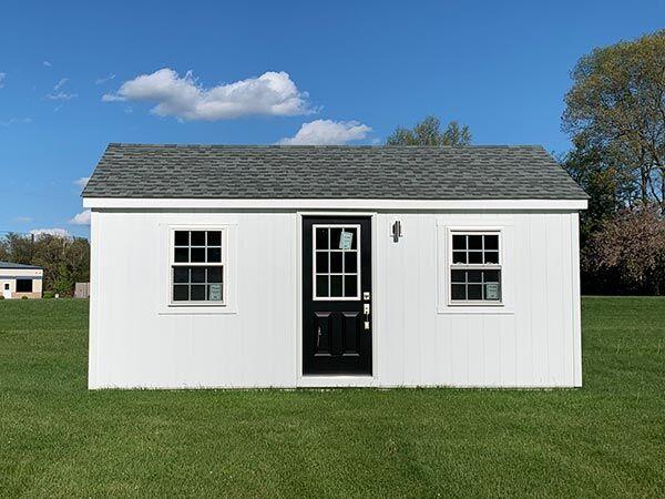 medium 12x20 amish built home with a black door