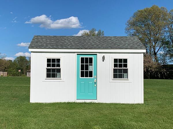 small 10x16 amish built home with teal door